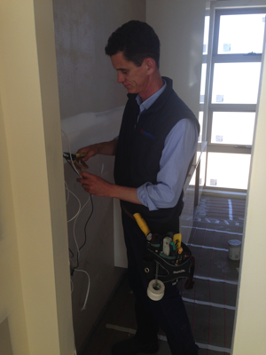 WIN Electrics technician installing a system